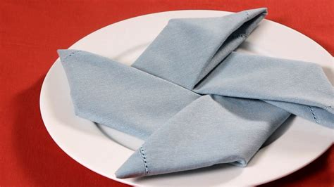 Napkin Origami - how to fold a napkin into a pinwheel napkin folding