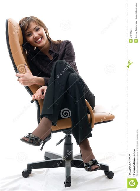 woman in an armchair woman sitting in an office armchair stock photography