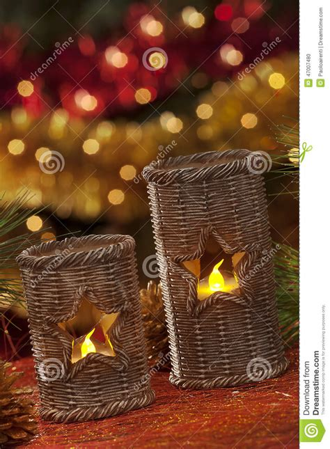 electric candles with christmas decorations in atmospheric