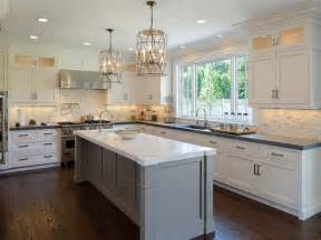 white kitchen with island faceted light pendants transitional kitchen blue