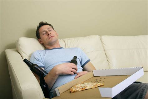 lazy guy on couch two weeks of no exercise can wreck your body men s