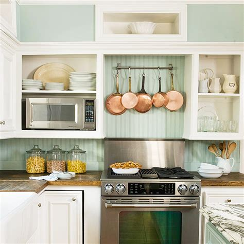 kitchen green painted wood kitchen cabinet with stove and beadboard backsplash cottage kitchen bhg
