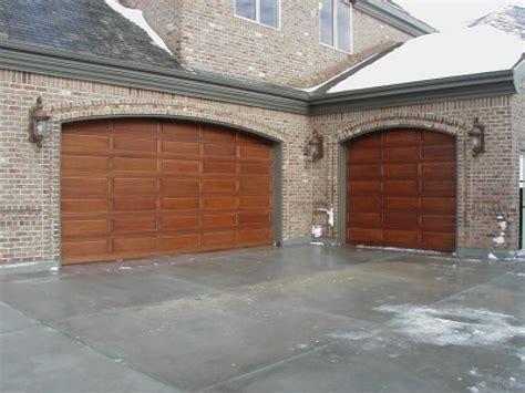 wood garage door replacement sections new door sales installation a plus garage doors