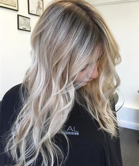 high lighted hair with gray roots blending white roots with blonde dark brown hairs