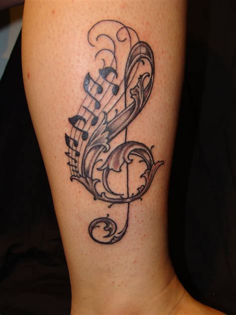 The Most Beautiful Tattoo Designs on Leg For Girls Cute Music Tattoo New Style for Leg 2011