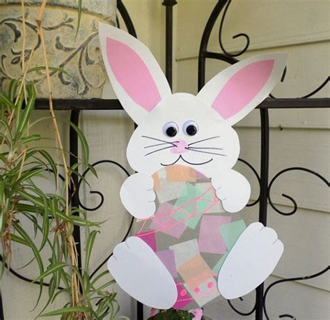 contact paper crafts bunny holding an easter egg suncatcher crafty morning