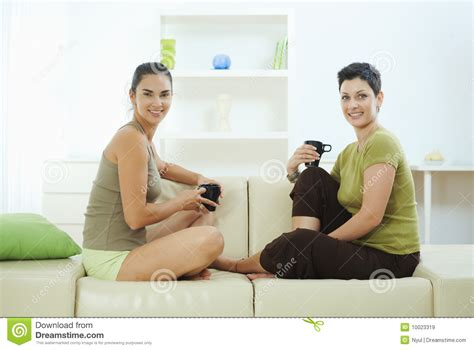 friends on couch friends sitting on couch stock image image of friendship
