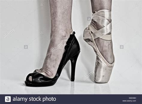 pointe high heels legs of a ballerina with a black high heel shoe in one