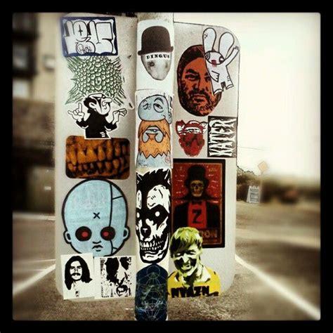 sticker covered street signs sticker street art