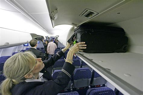 american airlines checked baggage airlines consider shrinking size limit for free carry on