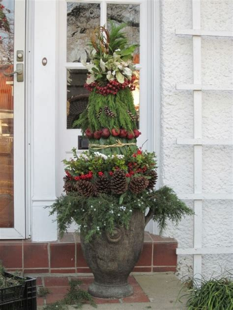 topiary created from winter greenery pinecone accents