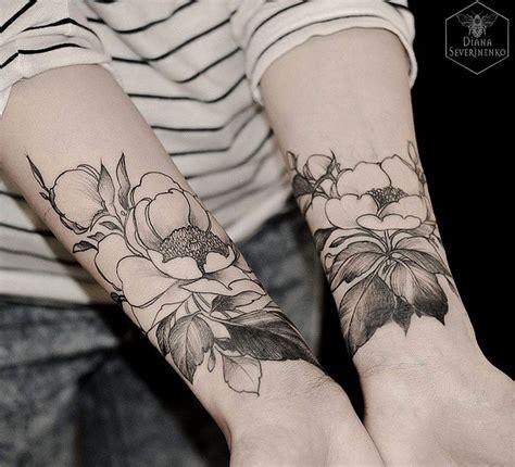 forearm flower tattoos diana severinenko a symmetrical blackwork flowers kiev