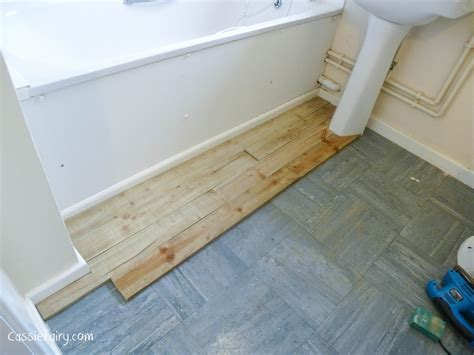 beach hut style bathroom using recycled wood from a skip to make a beach hut bathroom floor and storage