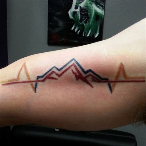 cardio mountains tattoo on bicep best tattoo ideas gallery
