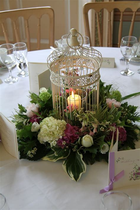 birdcage centerpieces weddings gold bird cage centerpiece with flower black feather arrangement inside wedding ideas 5 25