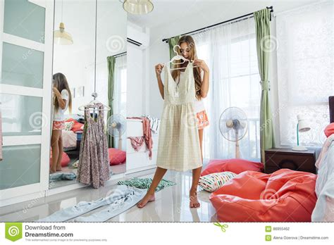 bedroom outfits for her teenage girl choosing clothing in closet stock photo