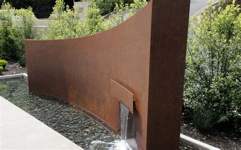cor ten steel wall with fountain architecture