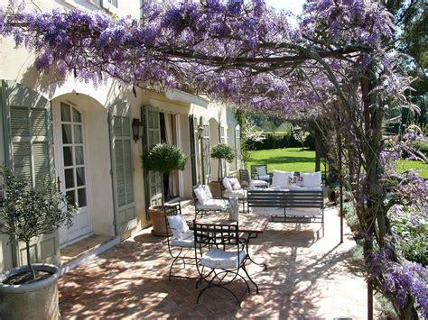 shuttered doors wisteria draped patio sooo