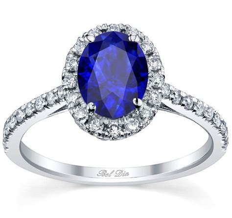 blue sapphire engagement ring with oval cut center and