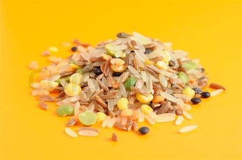 Lentil Split Mix whole grains beans soup mix rice split peas and lentils on yellow background stock photo