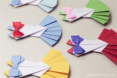 How To Make A Origami Bow And Arrow - 25 best ideas about origami dress on how to