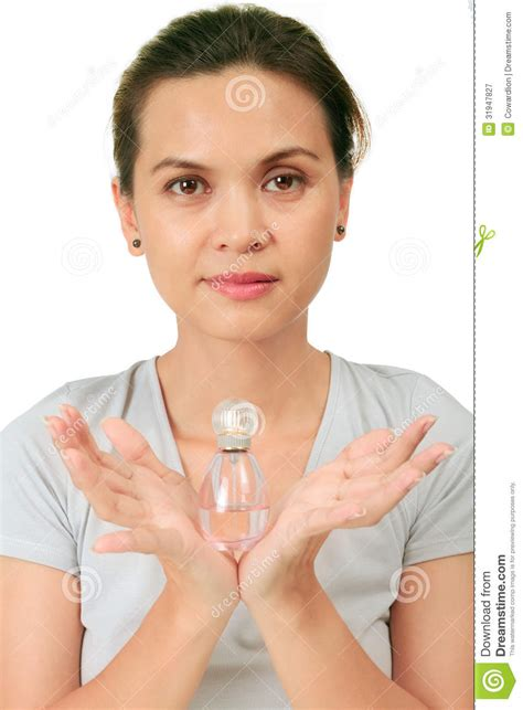 japanese middle age women middle age asian woman with a fragrance bottle royalty