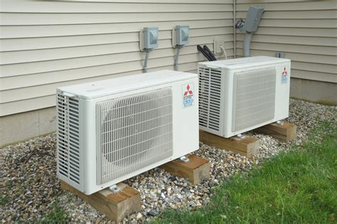 Ac Outdoor Mitsubishi just two minisplits heat and cool the whole house