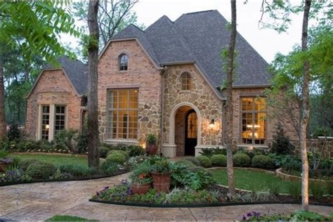 Brick House Houston by Brick And Frame An Arched Doorway Lush Landscaping
