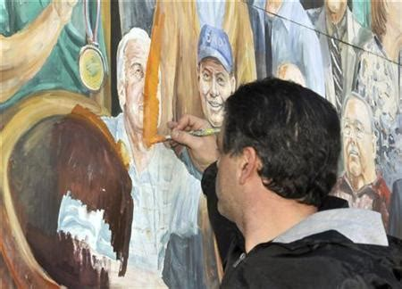 scorned penn state coach painted out of campus mural   reuters