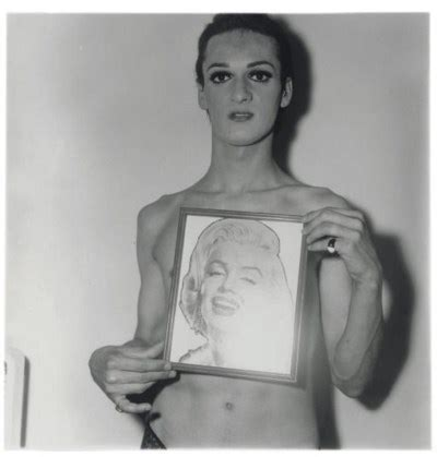 diane arbus (1923 1971) , transvestite with a picture of