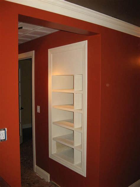 in wall media rack with secret door stashvault