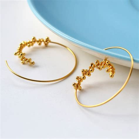 statement gold spiral hoop earrings by martha jackson
