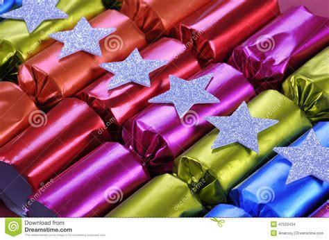 row of shiny festive christmas cracker bon bons stock