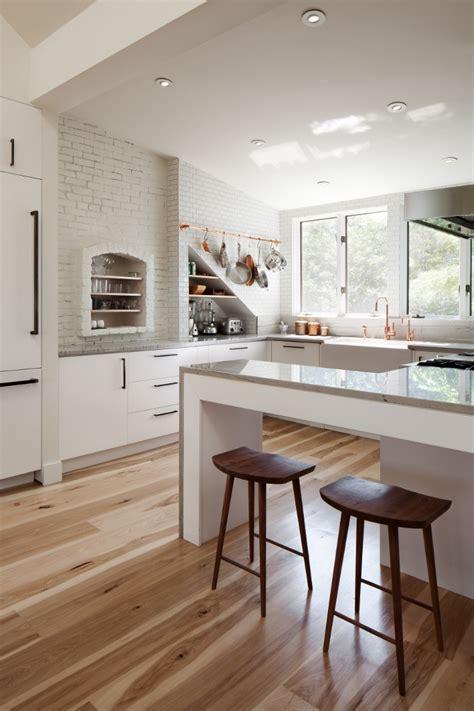 white kitchen with hardwood floors white kitchens with warm wood tone wood floors