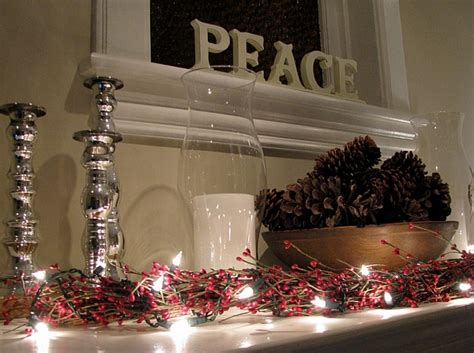enchanting fireplace mantel with red berries and natural