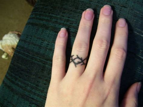 j tattoo on ring finger crown of thorns ring finger tattoo tattoos