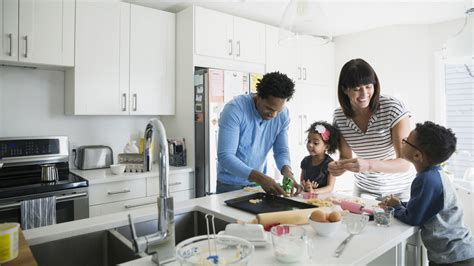 family in kitchen 5 fun and educational activities that get kids in the kitchen