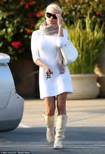 pamela anderson shows off legs in white frock as she goes
