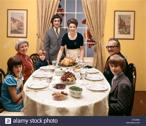 8 Things Not To Do On A Dinner by 1970s 3 Generation Family Turkey Dinner Stock Photo