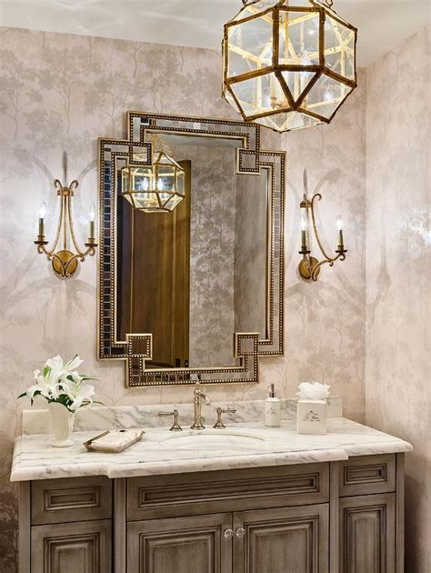 traditional brown and gold guest bathroom with oval mirror gold powder room wallpaper with light brown washstand