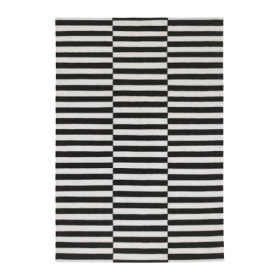 the glam that black and white striped rug