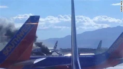 plane catches fire at las vegas airport cnn video