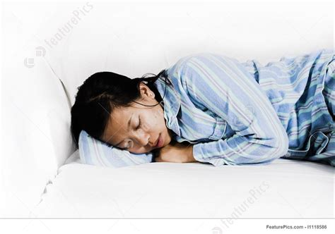 sleeping on the couch depression woman sleeping on couch stock photo i1118586 at featurepics