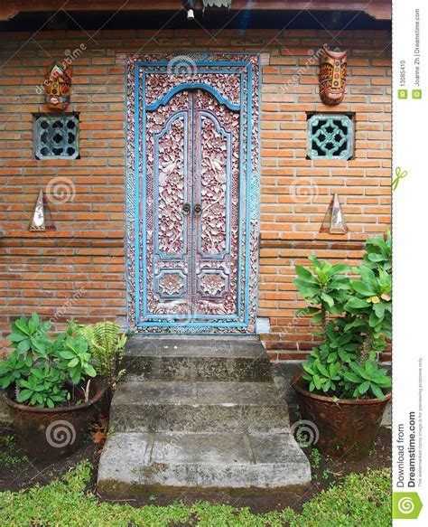 Beautifully Decorated Homes Pictures balinese carved wood door stock photo image 13085410