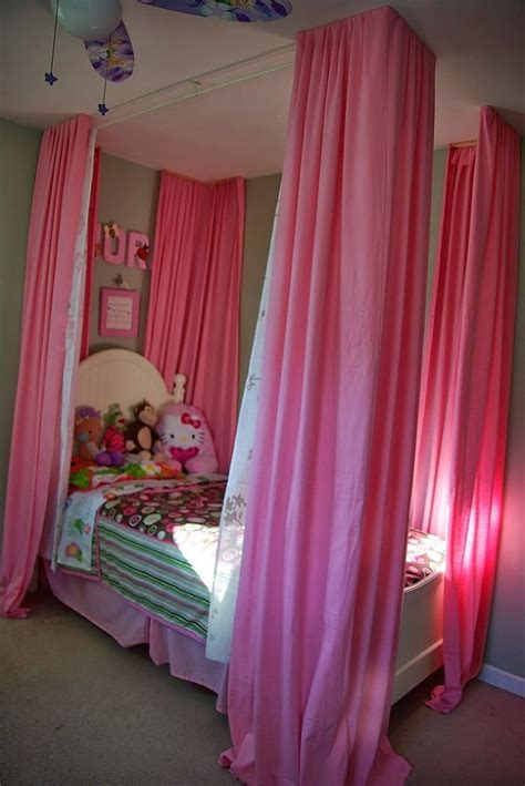 drapes over bed curtains over little girls bed bedrooms beds and