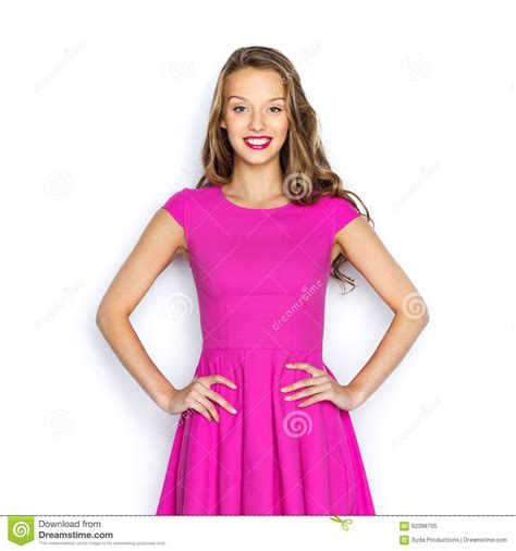 happy young woman  teen girl  pink dress stock photo