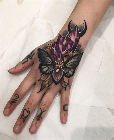 hand tattoo design moth crystals best design ideas