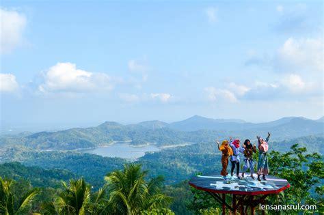 pule payung wisata alam  pemandangan waduk sermo