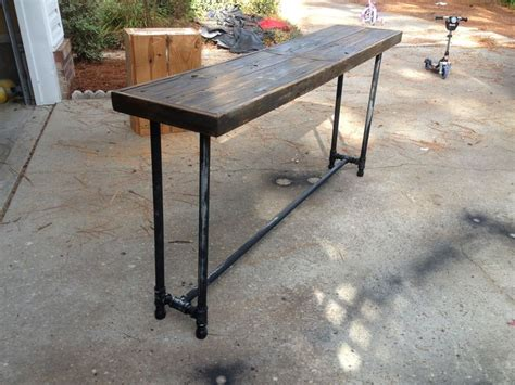 diy black pipe desk sofa table with wood washed ashore from the last hurricane
