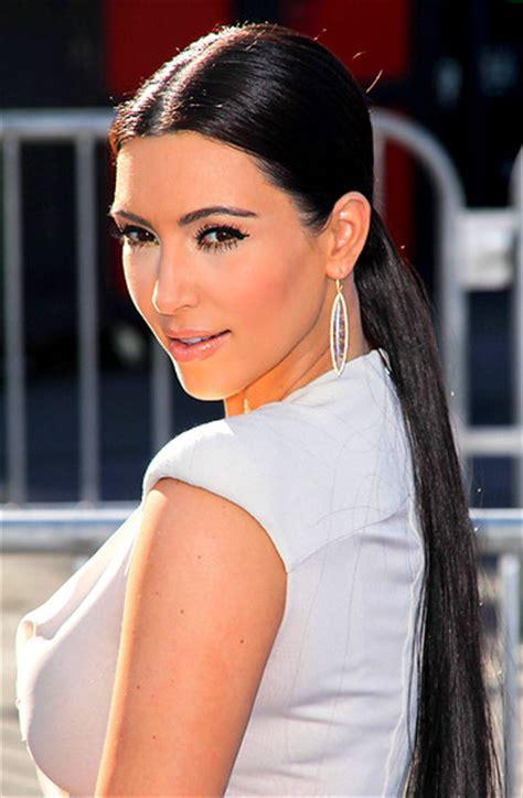 kim kardashians low sleek ponytail with center part celebrity soladunn s blog hair trend to try center part sleek